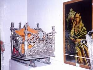Silver Doli and Photograph of Lady of the Royal family